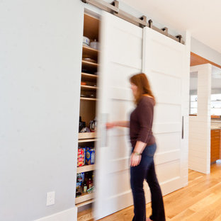 Kitchen pantry - mid-sized contemporary l-shaped light wood floor kitchen pantry idea in Atlanta with a farmhouse sink, flat-panel cabinets, medium tone wood cabinets, gray backsplash, stone tile backsplash, stainless steel appliances and an island