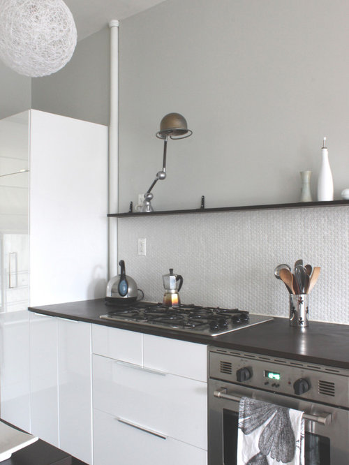 Nice Minimalist Kitchen Photo In New York With Flat Panel Cabinets, White  Cabinets And White