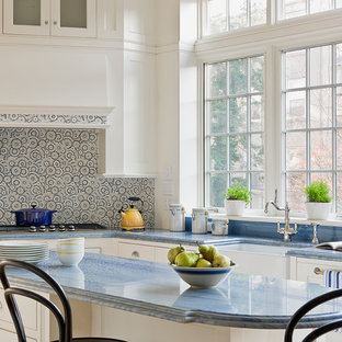 Inspiration for a traditional l-shaped eat-in kitchen in New York with a farmhouse sink, white cabinets, beaded inset cabinets, marble benchtops, multi-coloured splashback and blue benchtop.