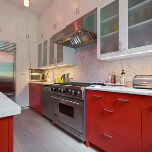 Design ideas for a mid-sized eclectic l-shaped eat-in kitchen in New York with an undermount sink, flat-panel cabinets, red cabinets, marble benchtops, white splashback, stone slab splashback, stainless steel appliances, ceramic floors and with island.