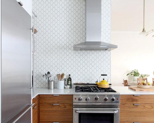 white backsplash ceramic backsplash and stainless steel appliances