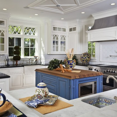 Example of a classic kitchen design in San Francisco with stainless steel appliances, white cabinets, white backsplash, wood countertops, a single-bowl sink and beaded inset cabinets