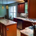Kitchen Renovation With Island And Angled Peninsula