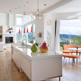 Inspiration for a contemporary galley open concept kitchen remodel in Portland with flat-panel cabinets and white cabinets