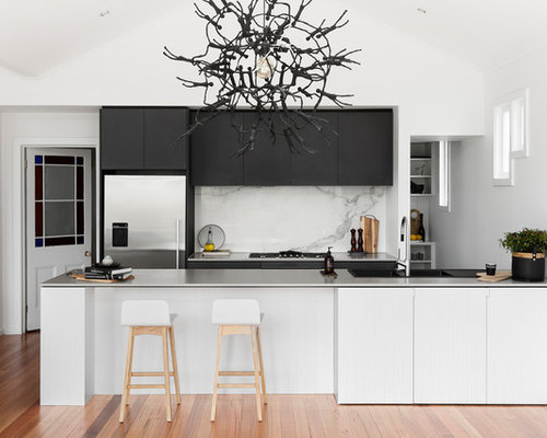 This Is An Example Of A Contemporary Galley Open Plan Kitchen In Melbourne  With An Integrated