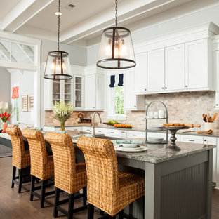 Traditional open concept kitchen appliance - Inspiration for a timeless dark wood floor open concept kitchen remodel in Charlotte with shaker cabinets, white cabinets, beige backsplash and an island