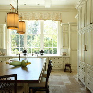 Example of a classic kitchen design in Atlanta with a farmhouse sink, raised-panel cabinets, white cabinets, white backsplash and marble countertops