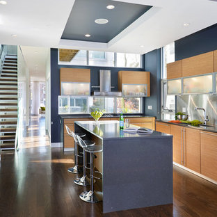Modern kitchen remodeling - Kitchen - modern u-shaped kitchen idea in Chicago with flat-panel cabinets, light wood cabinets and blue countertops