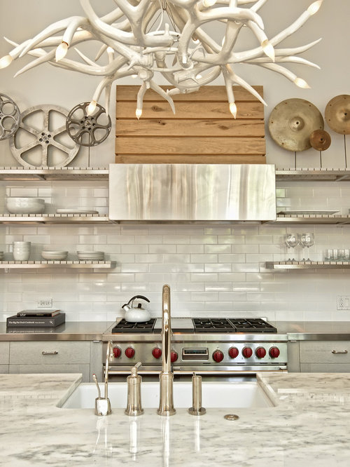 Kitchen - contemporary kitchen idea in Chicago with open cabinets, stainless  steel countertops, white