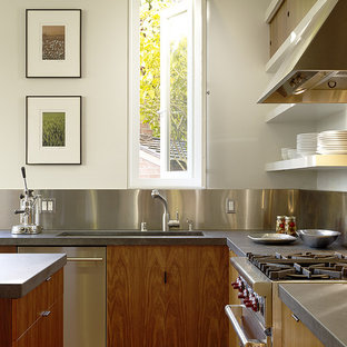 Inspiration for a modern l-shaped eat-in kitchen in San Francisco with flat-panel cabinets, metallic splashback, metal splashback, stainless steel appliances, light wood cabinets, soapstone benchtops and light hardwood floors.