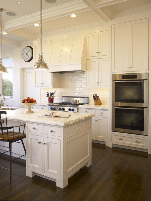 Elegant kitchen photo in San Francisco with beaded inset cabinets, white  cabinets, marble countertops