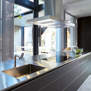 Large modern kitchen inspiration - Large minimalist l-shaped concrete floor and gray floor kitchen photo in Phoenix with an undermount sink, flat-panel cabinets, gray cabinets, concrete countertops, an island and stainless steel appliances