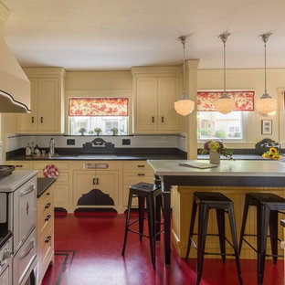 Photo of a medium sized traditional l-shaped kitchen pantry in Other with a submerged sink, shaker cabinets, yellow cabinets, granite worktops, white splashback, ceramic splashback, white appliances, lino flooring, an island, red floors and black worktops.