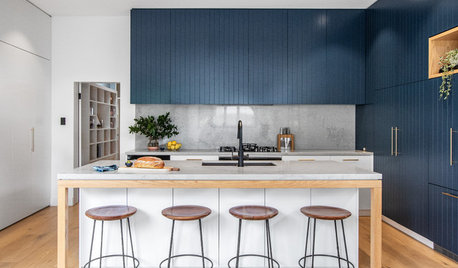 Room of the Week: A Compact Kitchen With a Stylish Hidden Laundry