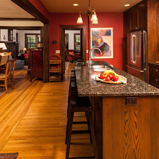 Craftsman kitchen ideas - Example of an arts and crafts kitchen design in Minneapolis with granite countertops