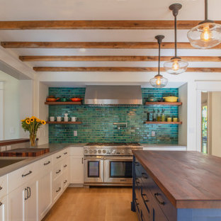 Craftsman kitchen appliance - Kitchen - craftsman l-shaped medium tone wood floor, brown floor and exposed beam kitchen idea in DC Metro with an undermount sink, shaker cabinets, white cabinets, green backsplash, stainless steel appliances, an island and gray countertops