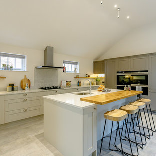 Design ideas for a country kitchen in Other with a submerged sink, shaker cabinets, grey cabinets, grey splashback, an island, grey floors and grey worktops.