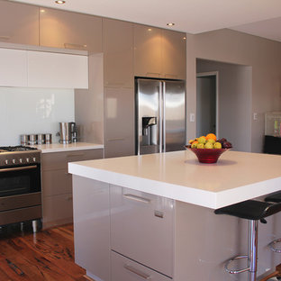 Mid-sized modern eat-in kitchen designs - Example of a mid-sized minimalist u-shaped dark wood floor eat-in kitchen design in Perth with a double-bowl sink, flat-panel cabinets, white cabinets, concrete countertops, white backsplash, glass sheet backsplash, stainless steel appliances and an island