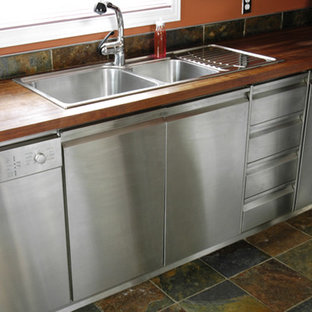 Butcher-block top on stainless steel cabinets