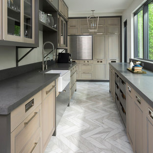 Photo of a large contemporary galley separate kitchen in Salt Lake City with a farmhouse sink, recessed-panel cabinets, stainless steel appliances, marble floors, no island, brown cabinets, concrete benchtops and grey floor.
