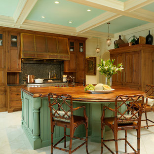 Kitchen - traditional kitchen idea in St Louis with recessed-panel cabinets, wood countertops, green cabinets, gray backsplash and paneled appliances