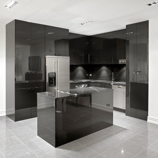 Trendy l-shaped kitchen photo in Melbourne with black cabinets, black backsplash and stainless steel appliances