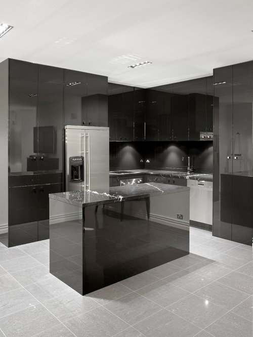 Trendy L Shaped Kitchen Photo In Melbourne With Black Cabinets, Black  Backsplash And Stainless