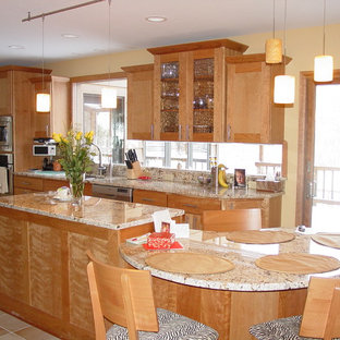 Design ideas for a large eclectic galley eat-in kitchen in Cleveland with an undermount sink, shaker cabinets, light wood cabinets, granite benchtops, window splashback, stainless steel appliances, porcelain floors, multiple islands and beige floor.