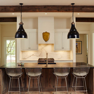 Inspiration for a mid-sized transitional single-wall open plan kitchen in Birmingham with shaker cabinets, wood benchtops, stainless steel appliances, with island, an integrated sink, white cabinets, white splashback, marble splashback, light hardwood floors and beige floor.