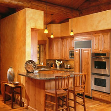 Rustic Kitchen by Teton Heritage Builders