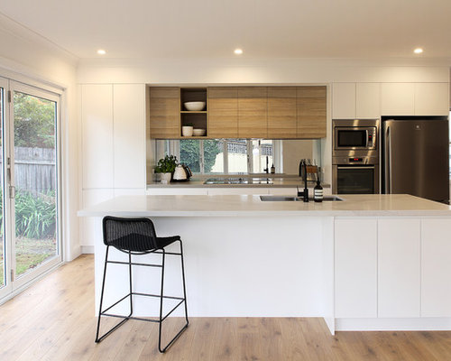 Inspiration For A Mid Sized Contemporary Galley Kitchen In Sydney With An  Undermount Sink,