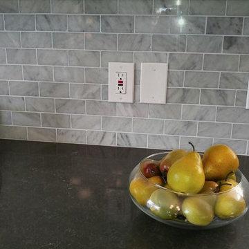 Caesarstone Piatra Grey Quartz Countertop with Carrara Marble Subway Tile