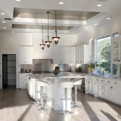 Inspiration for a mid-sized contemporary u-shaped medium tone wood floor eat-in kitchen remodel in Los Angeles with a double-bowl sink, raised-panel cabinets, white cabinets, granite countertops, white backsplash, mosaic tile backsplash, stainless steel appliances and an island