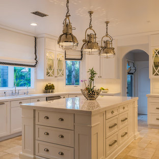 Design ideas for a large industrial u-shaped separate kitchen in Los Angeles with an undermount sink, shaker cabinets, white cabinets, quartz benchtops, white splashback, panelled appliances, ceramic floors, with island and beige floor.