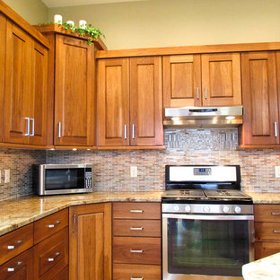 Calico Hickory cabinets with Brown Sugar stain and Golden Crystal granite