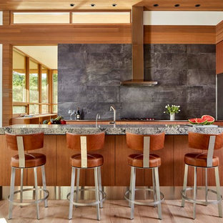 Design ideas for a midcentury eat-in kitchen in Other with flat-panel cabinets, medium wood cabinets, grey splashback, stainless steel appliances, light hardwood floors, with island, beige floor and grey benchtop.