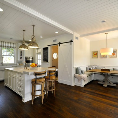 Inspiration for a coastal l-shaped dark wood floor open concept kitchen remodel in Los Angeles with a single-bowl sink, recessed-panel cabinets, cement tile backsplash and an island