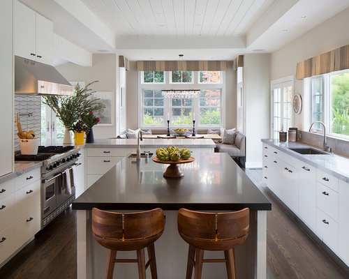 Example Of A Trendy Dark Wood Floor Eat In Kitchen Design In San Francisco  With