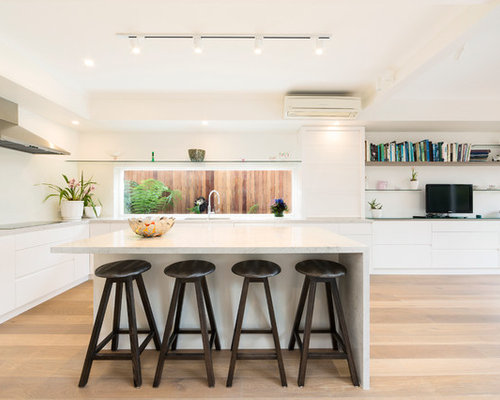Photo Of A Contemporary Kitchen In Melbourne With Flat Panel Cabinets,  White Cabinets,