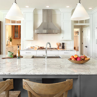 Large transitional eat-in kitchen appliance - Large transitional l-shaped light wood floor eat-in kitchen photo in New York with white cabinets, quartz countertops, white backsplash, subway tile backsplash, stainless steel appliances, an island, an undermount sink and beaded inset cabinets