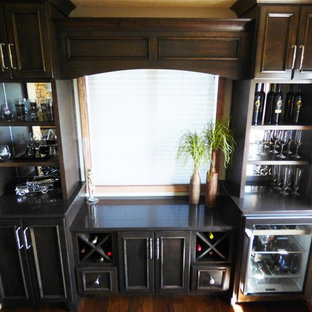 Example of a large classic l-shaped dark wood floor eat-in kitchen design in Other with an undermount sink, recessed-panel cabinets, medium tone wood cabinets, quartz countertops, gray backsplash, ceramic backsplash, stainless steel appliances and an island