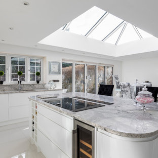 Large contemporary kitchen in Other with white cabinets, marble worktops, white splashback and stone slab splashback.