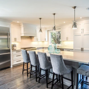 Mid-sized contemporary eat-in kitchen inspiration - Mid-sized trendy l-shaped medium tone wood floor eat-in kitchen photo in Toronto with a double-bowl sink, shaker cabinets, white cabinets, quartz countertops, stainless steel appliances and an island