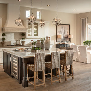 Eat-in kitchen - transitional galley eat-in kitchen idea in Phoenix with recessed-panel cabinets, white cabinets, soapstone countertops, white backsplash, subway tile backsplash and stainless steel appliances