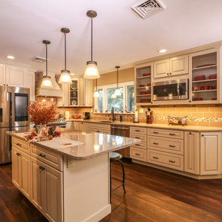 Mid-sized transitional u-shaped eat-in kitchen in Other with an undermount sink, raised-panel cabinets, beige cabinets, quartz benchtops, brown splashback, porcelain splashback, stainless steel appliances, vinyl floors, with island and brown floor.