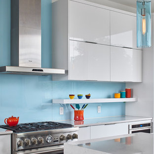 Large modern open concept kitchen inspiration - Example of a large minimalist l-shaped dark wood floor open concept kitchen design in Ottawa with an undermount sink, flat-panel cabinets, white cabinets, quartzite countertops, blue backsplash, glass sheet backsplash, stainless steel appliances, an island and green countertops