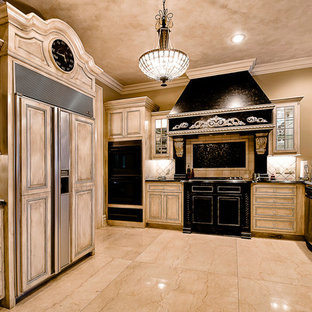 Traditional kitchen inspiration - Example of a classic kitchen design in Little Rock with black appliances