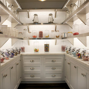 Photo of a traditional kitchen pantry in New York with subway tile splashback.
