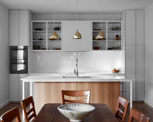Photo Of A Modern Galley Eat In Kitchen In Melbourne With Flat Panel  Cabinets