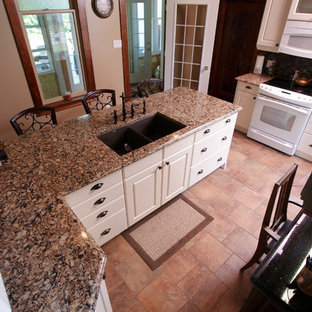 This is an example of a medium sized farmhouse galley enclosed kitchen in Toronto with a double-bowl sink, beaded cabinets, white cabinets, granite worktops, grey splashback, mosaic tiled splashback, white appliances, cement flooring, an island, orange floors and brown worktops.